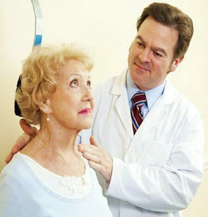 doctor treating an older female patient