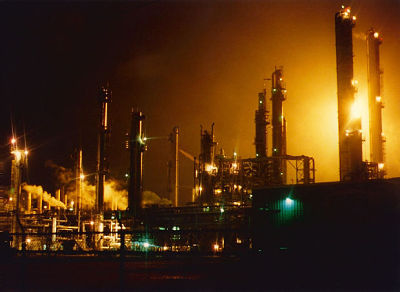 Image of refinery smoke stacks.